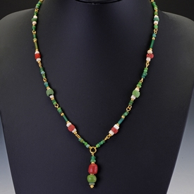 Necklace with Roman green, red glass and shell beads
