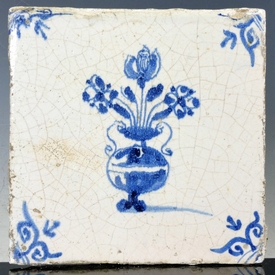 Dutch Delft blue and white tile with tulip and flower vase