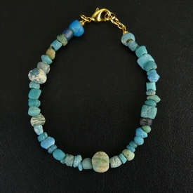 Bracelet with Roman turquoise glass and faience melon bead