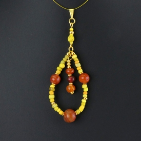 Pendant with Roman yellow glass and carnelian beads