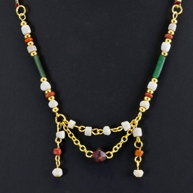 Necklace with Roman green, orange glass and shell beads