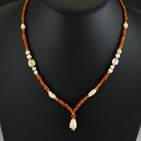 Necklace with Roman orange glass and shell (amulet) beads