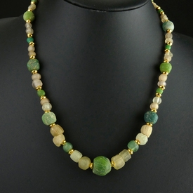 Necklace with green and semi-translucent glass beads