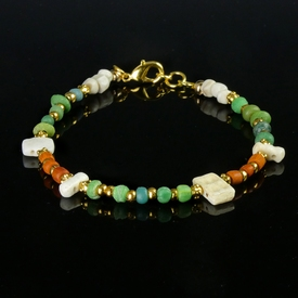 Bracelet with Roman green, orange glass, shell and amulet
