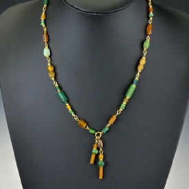 Necklace with Roman green and amber colour glass beads