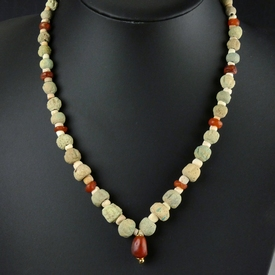 Necklace with Egyptian faience, shell and carnelian beads