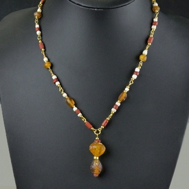 Necklace with Roman red and amber glass and shell beads