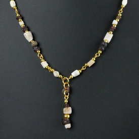 Necklace with Roman purple glass, shell and stone beads