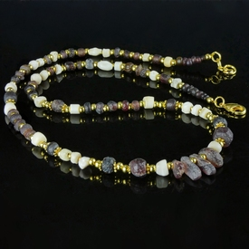 Necklace with Roman purple glass and shell beads
