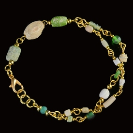 Bracelet with Roman green glass and shell beads