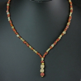 Necklace with Roman red and semi-translucent glass beads