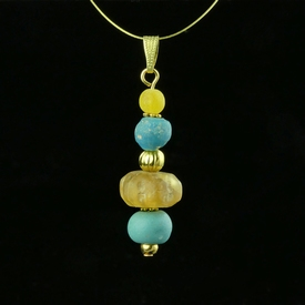 Pendant with Roman turquoise and yellow glass beads