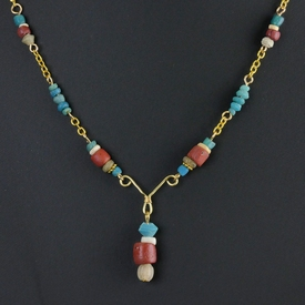 Necklace with turquoise, red glass and shell beads