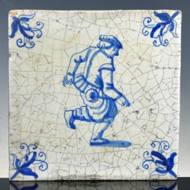 Dutch Delft blue and white tile, dancing man