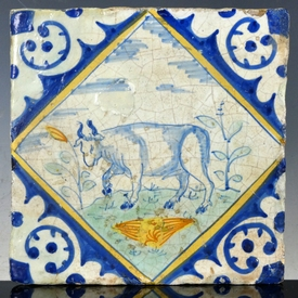 Dutch Delft polychrome tile with bull, majolica