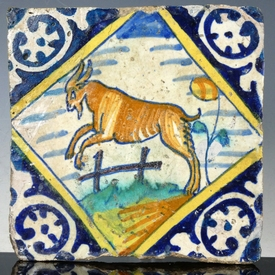 Dutch Delft polychrome tile with jumping goat, majolica