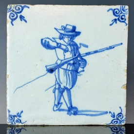 Dutch Delft blue and white tile, soldier loading musket