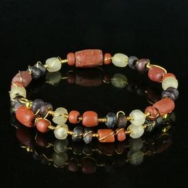 Bracelet with Roman red, purple, semi-translucent glass