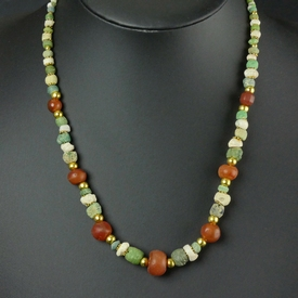 Necklace with Roman green glass, faience and carnelian beads