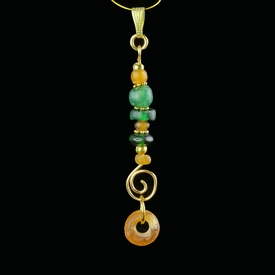 Pendant with Roman green and amber colour glass beads