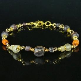 Bracelet with Roman purple, semi-translucent, orange glass