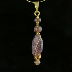 Pendant with Roman purple glass beads