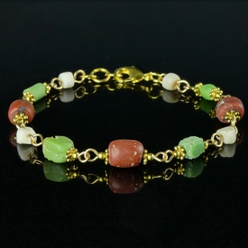 Bracelet with Roman red, green glass and shell beads
