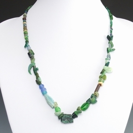 Necklace with Roman glass beads and bronze amulet