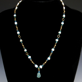 Necklace with Roman glass and shell beads