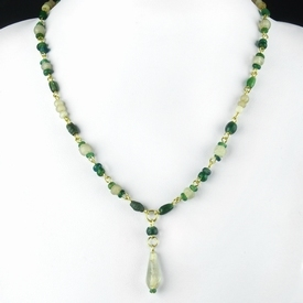 Necklace with Roman green glass and semi-translucent beads