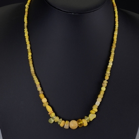 Necklace with yellow Roman glass and decorated ceramic beads