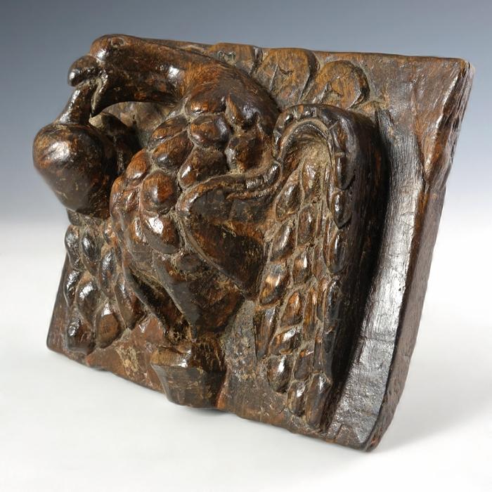 Antique oak wood panel with eagle