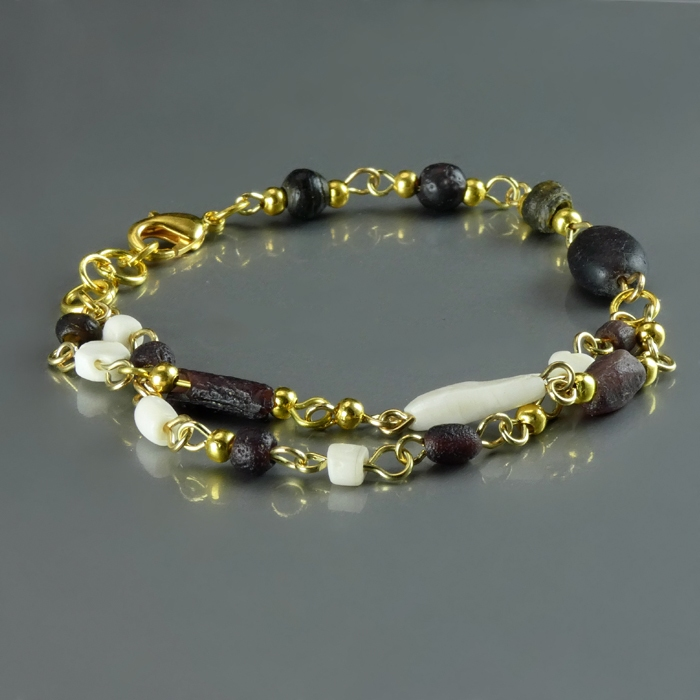 Bracelet with Roman purple glass and shell beads