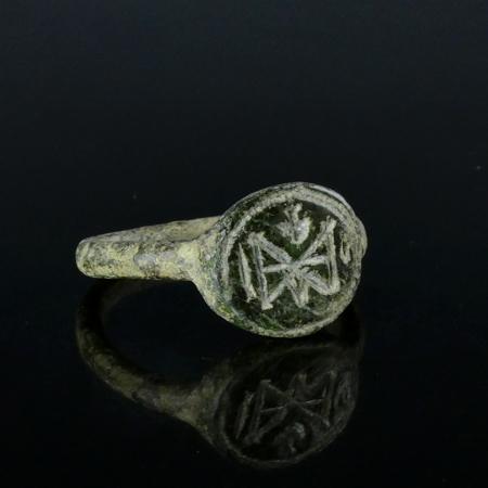 Byzantine bronze ring with monogram and cross