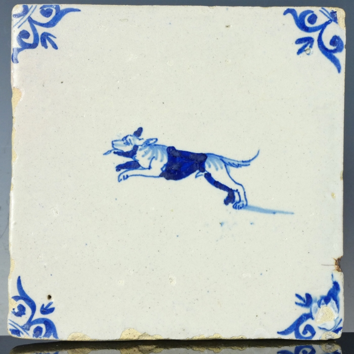 Dutch Delft blue and white tile, jumping dog