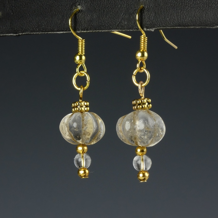 Earrings with ancient rock crystal melon beads