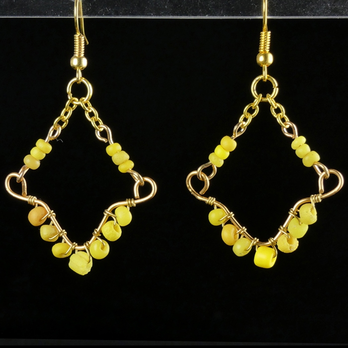 Earrings with Roman wire-wrapped yellow glass beads
