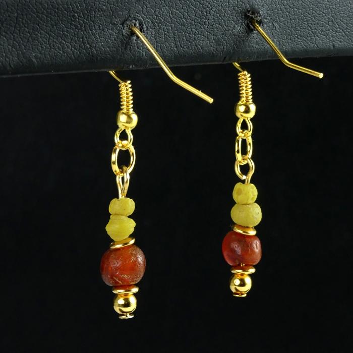 Earrings with yellow Roman glass and carnelian beads