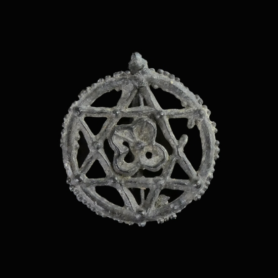 Medieval pewter badge, Star with flower