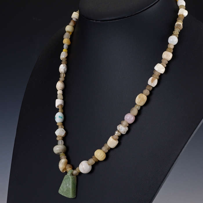Necklace with Roman glass and stone beads with stone amulet