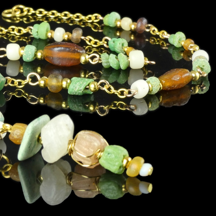 Necklace with Roman green, white and amber glass beads