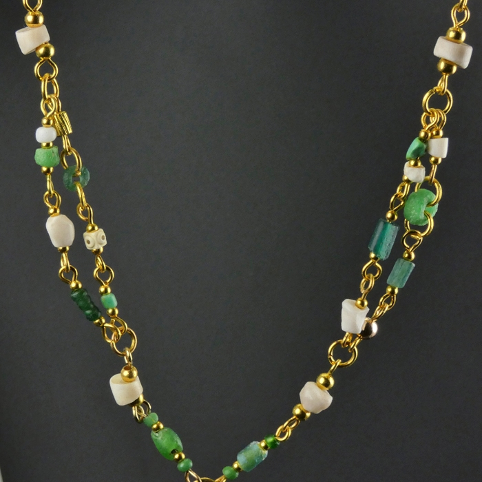 Necklace with Roman green glass and shell beads