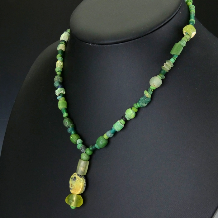 Necklace with Roman green glass and stone beads