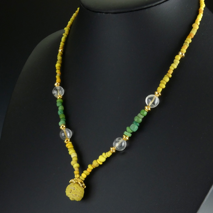 Necklace with Roman yellow, green glass & rock crystal beads