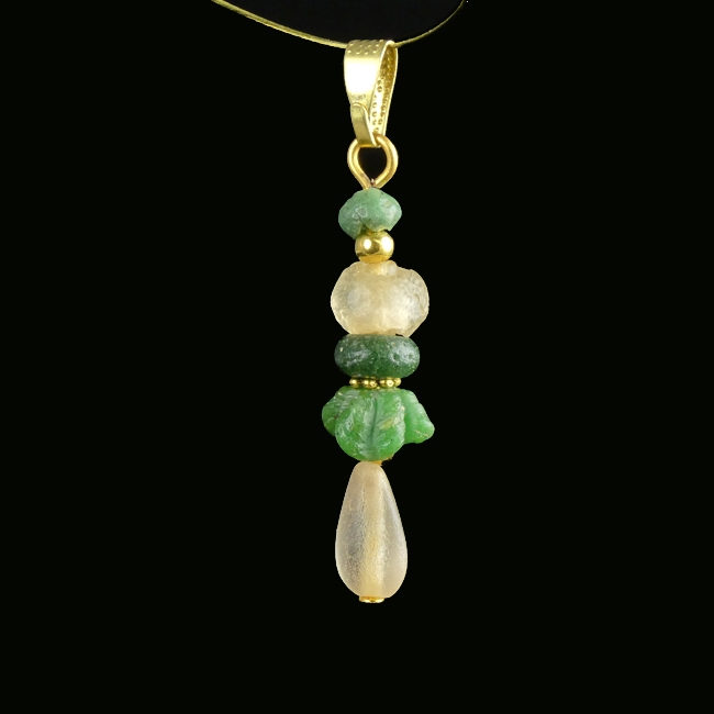 Pendant with Roman green and semi-translucent glass beads