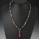 Ancient Egypt, necklace with faience and carnelian beads