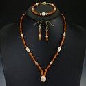 Necklace, bracelet & earrings with Roman orange glass beads