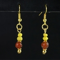 Earrings with yellow Roman glass and carnelian beads