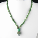 Necklace with Roman green glass beads, including melon bead