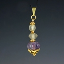 Pendant with semi-translucent glass and amethyst melon beads